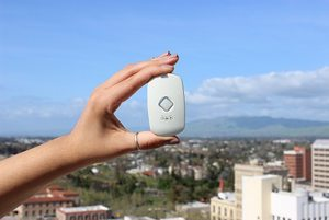 hand holding pax with city background