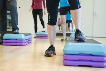 people doing step training aerobic exercise
