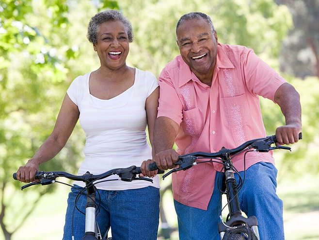 happy couple biking