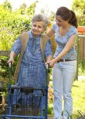 caregiver and senior in yard