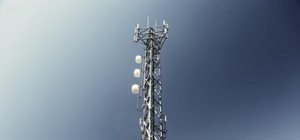 A cell tower with blue skies
