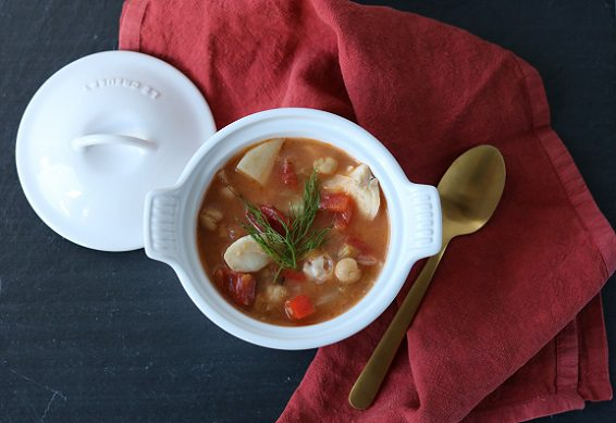 A bowl of hearty chickpea and cod stew