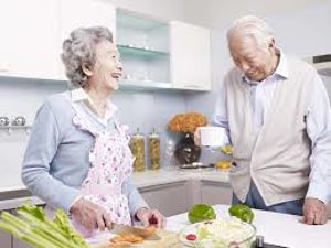 couple laughing while cooking