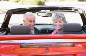 couple in red convertible 2