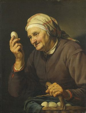 woman gazing upon an egg