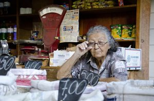 female senior in market