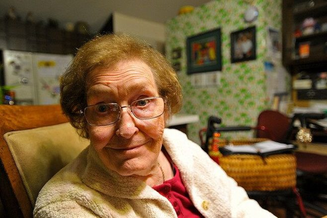 grandma with glasses smiling