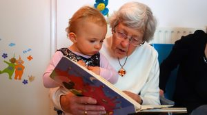 grandma reading to grandchild