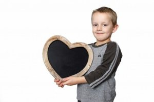 kid with blackboard heart