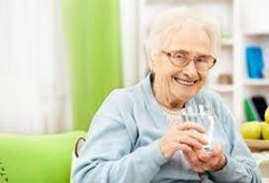grandma drinking milk. alert1 medical alert system