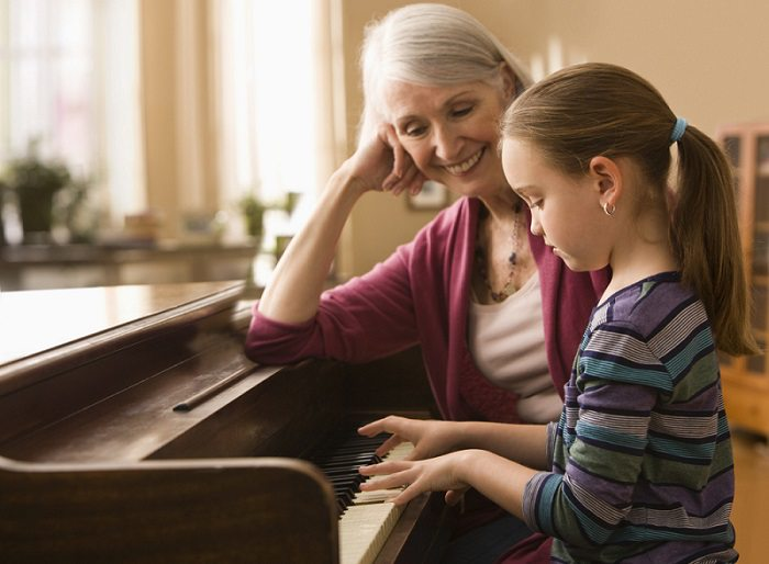 Grandmother teach granddaughter piano.alert1 medical alert systems