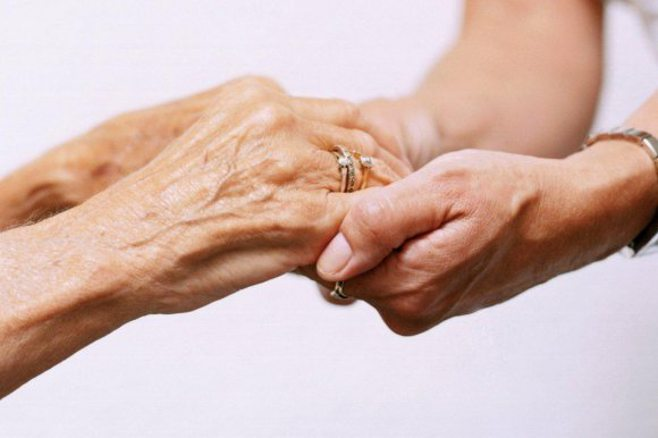 aged hands holding young hands