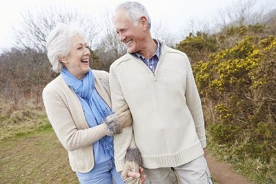 happy couple outdoors with mobile senior alert