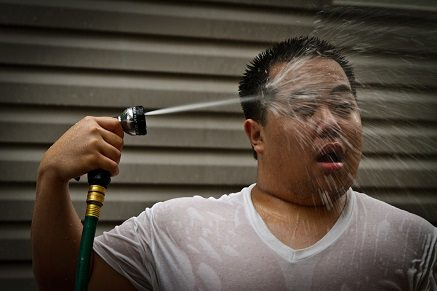 Man cooling himself off with water