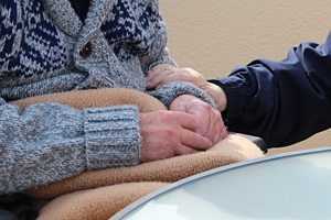 Holding And Caring Senior Hands