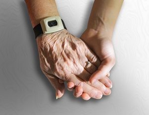 holding hands with alert1 medical alert bracelet