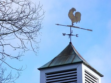 roof with compass and rooster
