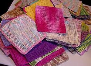 pile of colorful crochet dishcloths