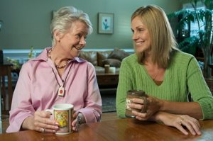 Senior Mother and Daughter Drinking Coffee