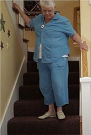 woman on stairs.alert1medicalalertsystems