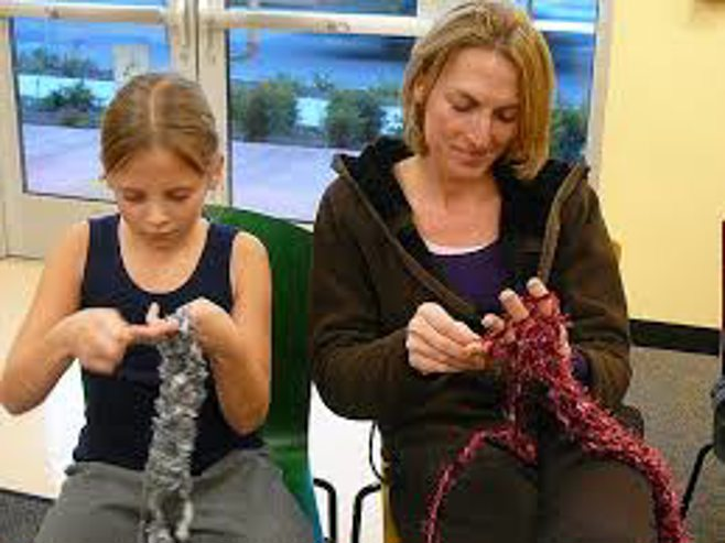 mother and daughter knitting together