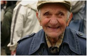 old man with hat smiling