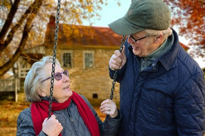 seniors on swings outdoors with mobile medical alert