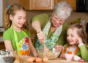 older-woman-near-two-little-girls-cooking. alert1 medical alert system