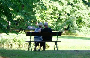 couple on bench outdoors thanks to a mobile medical alert