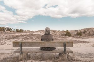 grandma on bench in desert