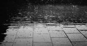 Rain falling on the pavement