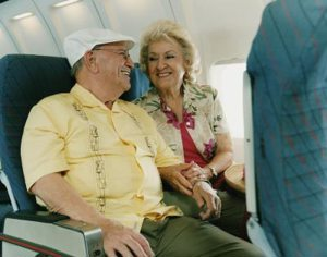 senior couple on a plane