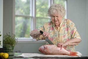 Senior woman prepping fish