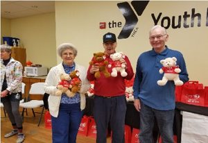 Seniors holding teddy bears
