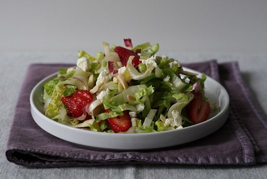 Strawberry and endive salad with feta and almonds