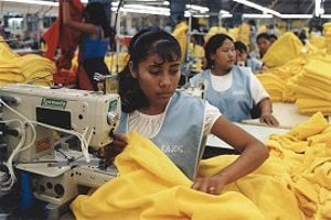Workers in a sweatshop sewing