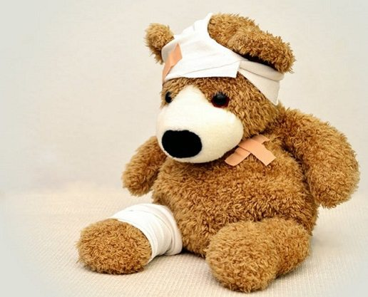 hurt teddy bear in bandages