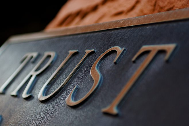 Metal plate with the word trust