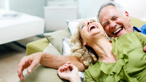 two couples laughing on a couch. alert1 medical alert systems