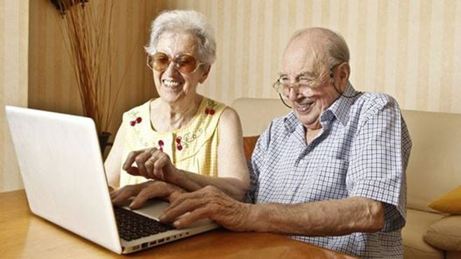 two elderly on a computer. alert1 medical alert systems
