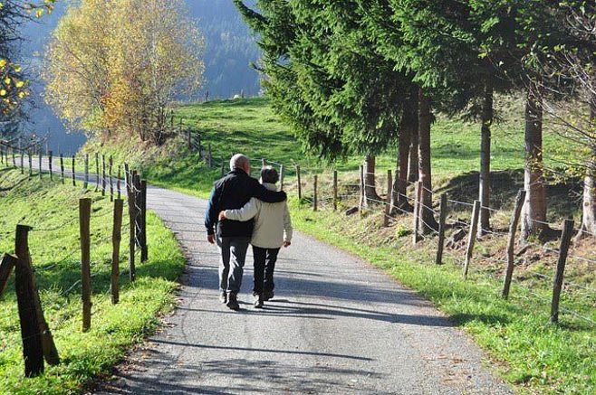 couple walking on rural trail