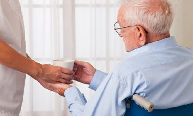 man getting water from caregiver