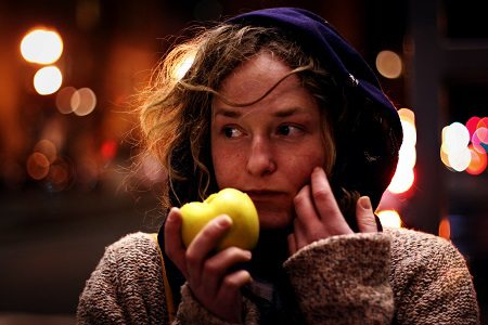 woman eating an apple.alert1