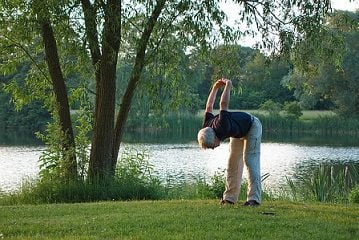 yoga man stretching outdoors